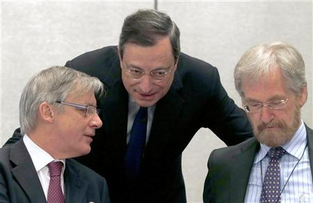 ECB President Draghi speaks to France's Central Bank Governor Noyer and ECB Member of Executive Board Praet in Barcelona